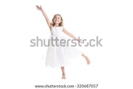 A Little girl wearing white dress on studio - stock photo