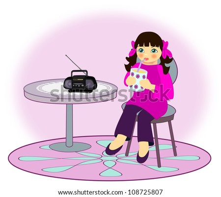 A little girl who sits and drinks from a cup while she is listening the radio. - stock photo