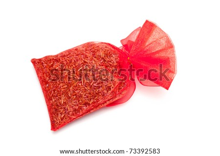 a little red bag with lavender seeds - stock photo