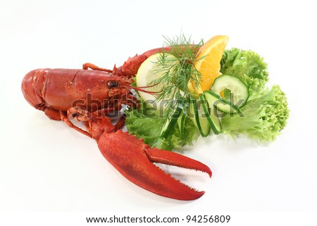 a lobster with salad, orange and cucumber - stock photo