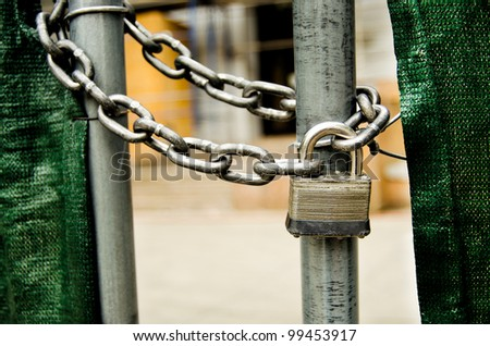 a lock and chain on gate - stock photo
