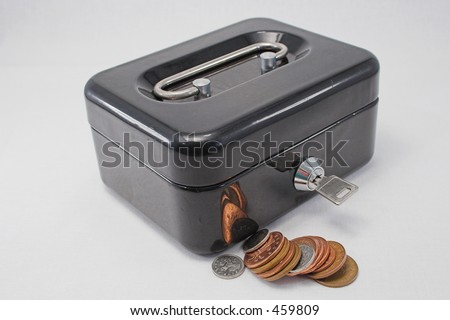 A lockable strongbox and cash - stock photo