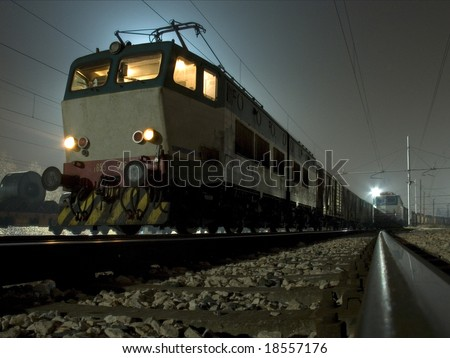 a locomotive in the night - stock photo