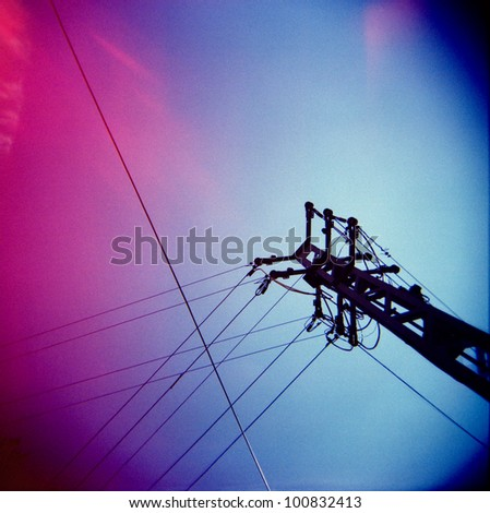 a lomography of a transmission tower - stock photo