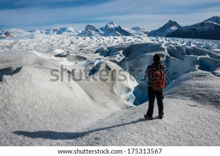 A lone man admiring the stunning views of Perito Moreno Glacier, Argentina. - stock photo