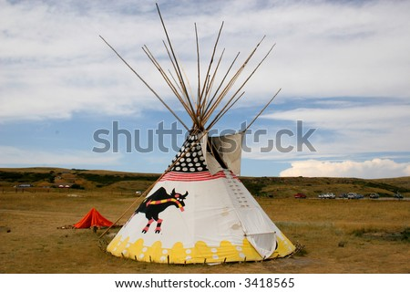 """A lone teepee set up below """"Heads Smashed in Buffalo Jump"""", Alberta, Canada. - stock photo"""