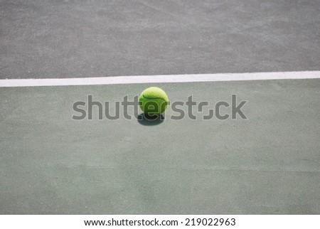A lonely tennis ball on the playground - stock photo