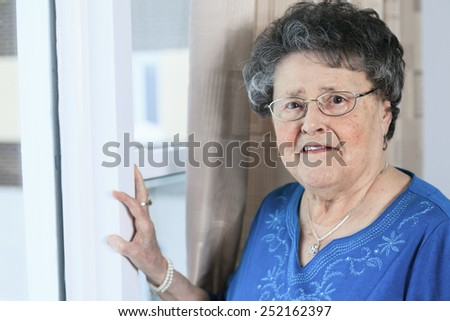 A lonely 90 years old grandmother in is apartment - stock photo