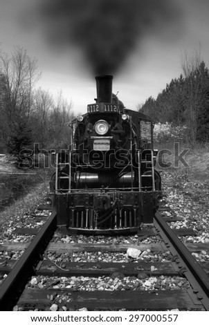 A long black train photographed in black and white. - stock photo