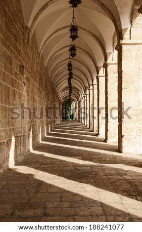 A long corridor on the top of the Temple Mount in the Old City of Jerusalem in Israel leads to the Chain Gate. - stock photo