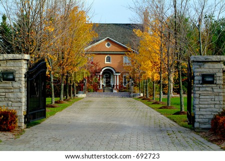 A long driveway to a beautiful country estate - stock photo
