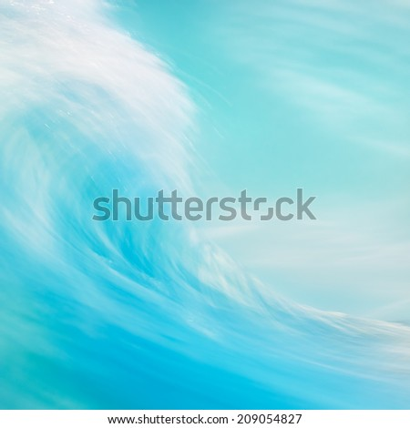 A long exposure abstraction of an ocean wave breaking onshore.  - stock photo