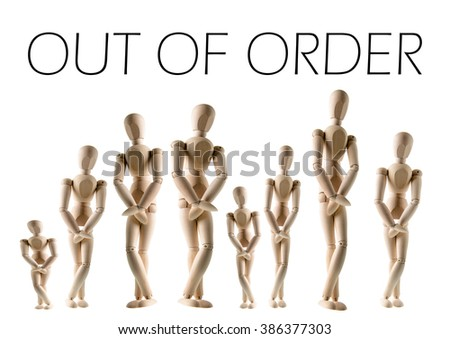 A long line of wooden figures are patiently waiting to go to the bathroom. - stock photo