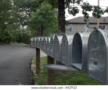 A long row of mail boxes outside this apartment complex - stock photo