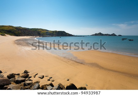 A long stretch of an untouched beach on Dongju Island in the Matsu Islands of Taiwan - stock photo