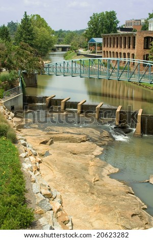 A look down the Reedy River in downtown Greenville, SC. - stock photo