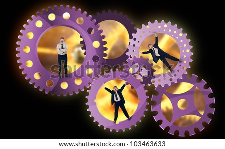 A look into the enterprise - teamwork concept with businessman inside cogwheels - stock photo