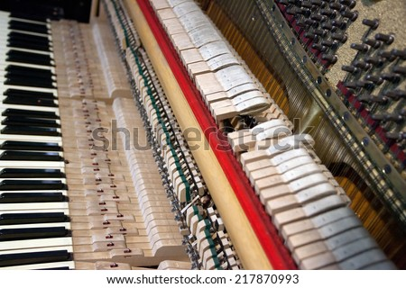 a look into the inside of a piano - stock photo