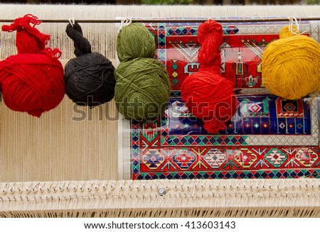 A loom for weaving authentic, traditional, oriental rugs, carpets with hand spun and natural dyed wool yarns. Sketch of the pattern is an important part of this art. - stock photo