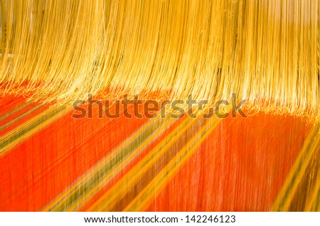 A loom prepared for weaving - stock photo