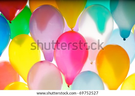 A lot of air balloons isolated on white background - stock photo