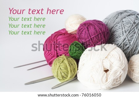 A lot of bright balls of yarn and knitting needle - stock photo
