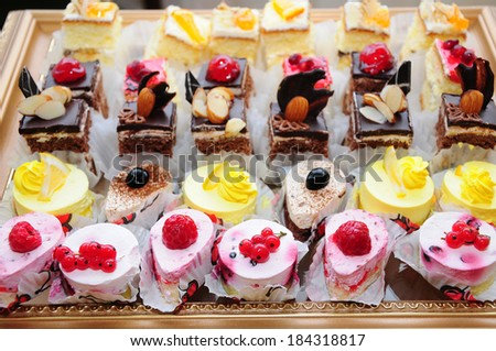 A lot of cakes on celebratory table - stock photo