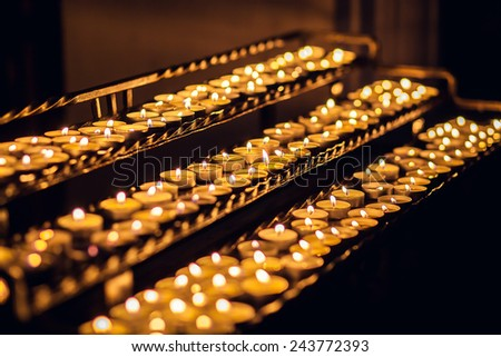 a lot of candles in church - stock photo