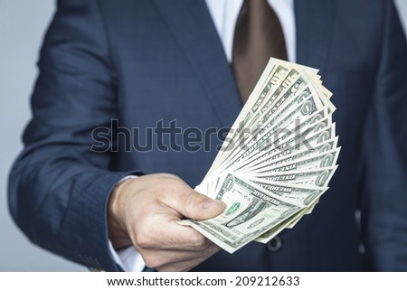 a lot of cash for the lucky - stock photo