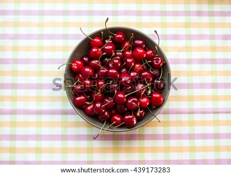 A lot of cherries. Cherries in a bowl on the table. Crop, orchard, berries. Healthy nutrition. Ripe berries. In the kitchen. Diet. Cherry plate. Still life food. - stock photo