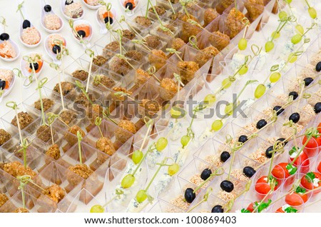 a lot of cold snacks on buffet table, catering, shallow DOF - stock photo