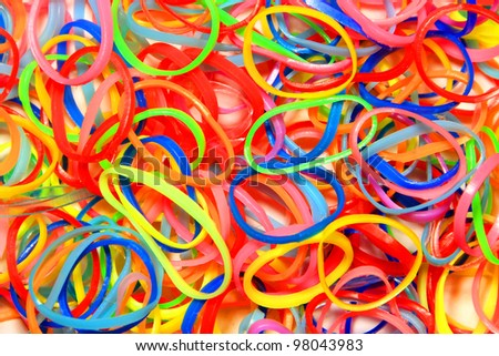 A lot of colored elastic bands - stock photo