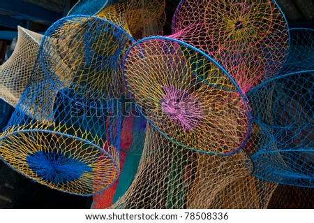 a lot of colorful fishing-nets - stock photo
