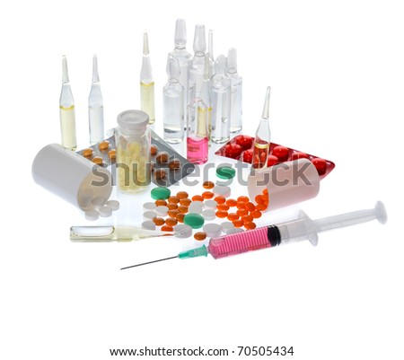 a lot of colorful pills and ampoules on white background - stock photo