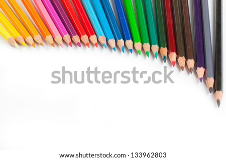 A lot of coloured crayons in a rainbow of colours - stock photo