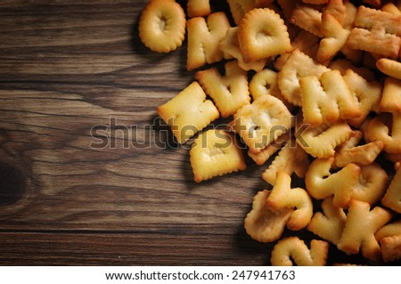 a lot of Cookies ABC on wooden background - stock photo