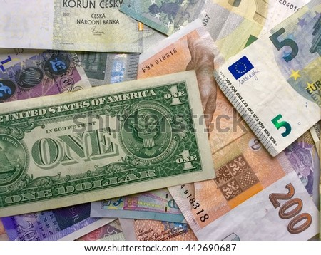 a lot of currencies from all around the world. Euro, Dollar, Czech crown, Pound. Bank notes on table - stock photo