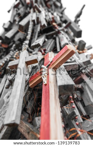 A lot of different crosses most of wood tied to support as memorial. Composition of crosses in memory of dead. Place to remember and honour memory of people. Religion and faith. - stock photo