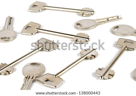 A lot of different keys on a white background - stock photo