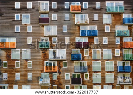 A Lot of Different Kinds of Windows on the Same Building - stock photo
