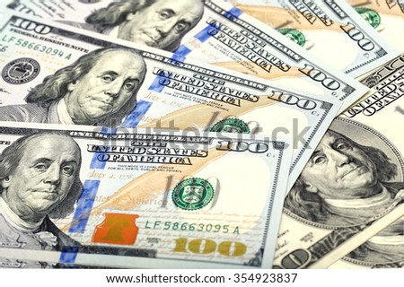 A lot of 100 dollar bank-notes with shallow depth of field. Mone - stock photo