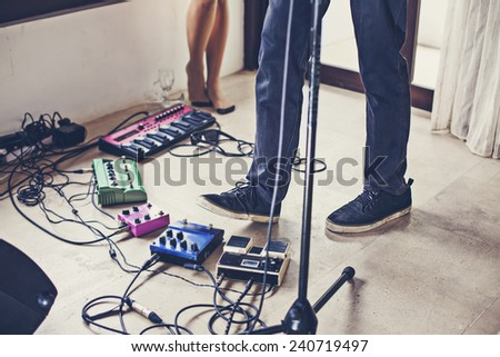 a lot of equipment in a private musical studio - stock photo