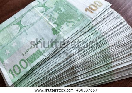 A lot of 100 euro banknotes. European money. - stock photo