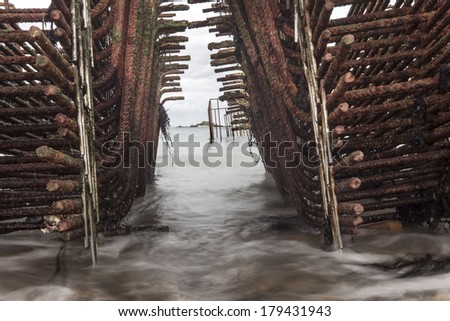 A lot of fishing metal grid boxes coastline, in france - stock photo