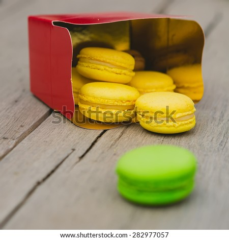 A lot of french colorful macarons. shallow dof - stock photo