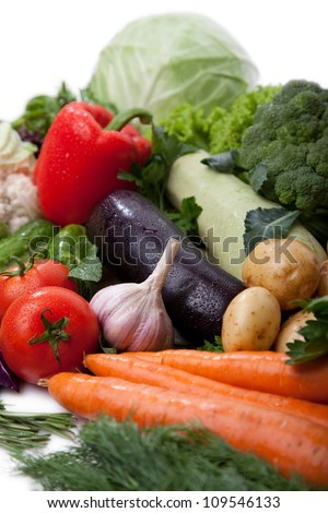A lot of fresh, different vegetables on white. - stock photo