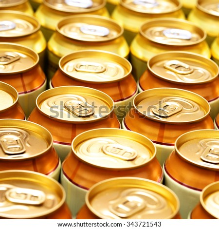 A lot of gold beer cans. Shallow DOF - stock photo