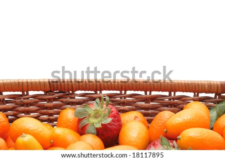 A lot of kumquats an strawberry in a basket isolated on white background - stock photo