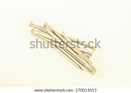A lot of metal spikes,isolated on white background - stock photo