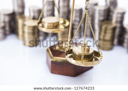 A lot of money! Coins on scales - stock photo